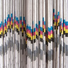 newspapers-stacked-colorful-cc